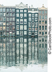 Winter snow view of Dutch canal houses in Amsterdam
