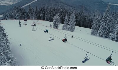 Winter Snowboarding and Ski drone flight in mountains...