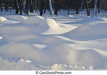 Winter snowdrifts in a sunny cold day