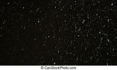Winter snowfall at night bottom view. Video 4k.