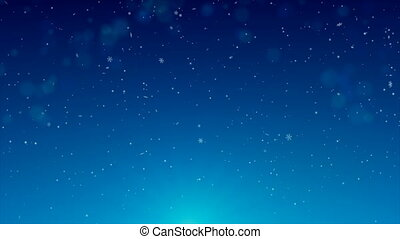 Winter snowfall on blue background with effect of bokeh....
