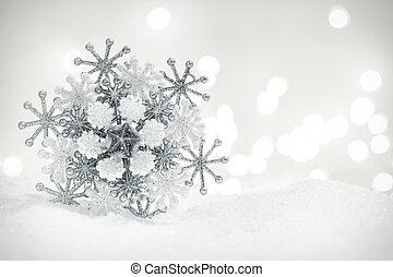Winter snowflake decoration on glitter background.