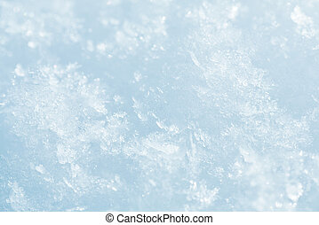 Winter snowflakes on snow surface (macro)