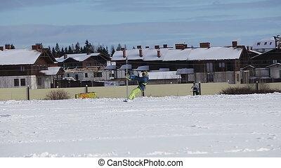 Winter snowkiting on the field.