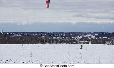 Winter snowkiting on the field. - Man ride on winter...