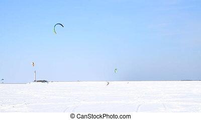 Winter Snowkiting on the ice lake