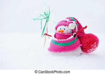 winter snowman standing in snow