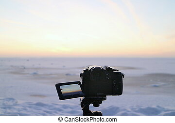 winter snowy landscape, camera in the foreground