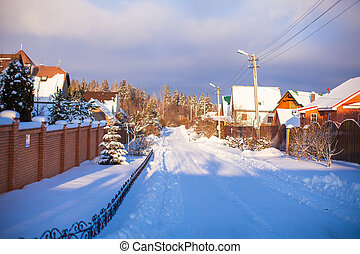 Winter snowy landscape with houses in a small village