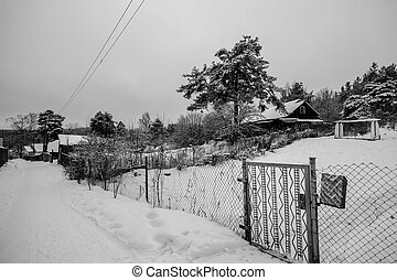 Winter snowy rural landscape in the nord of Russia. Black and white photo.
