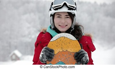 Winter sport, snowboarding - portrait of young snowboarder...