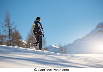 Winter sports walk in the snow on the Alps