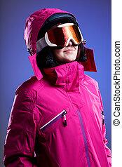 Winter sportswoman in pink - A woman in a pink winter jacket...