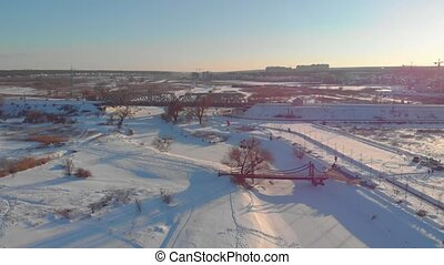 Winter steel bridges before sunset aerial drone view right side flying around camera movement Irpin Ukraine