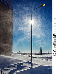 Winter storm in city at sunny day