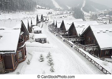 alpine village - winter street in alpine village under ...