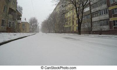 Winter street, snow in the city.
