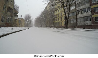 Winter street, snow in the city.