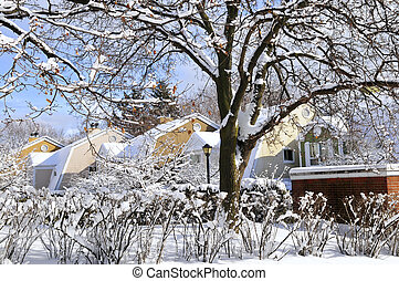 Winter street with lots of snow and colorful houses in ...