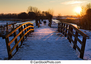 Winter stroll - Winter landscape at sunset in the...