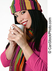 Winter styled woman holding a coffee mug