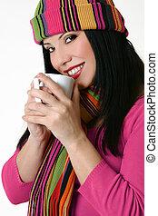 Winter styled woman holding a coffee mug