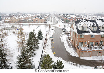 Wideangle, elevated view of a gray winter suburban landscape.