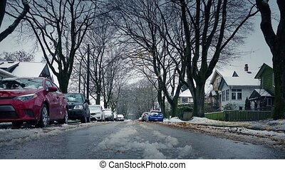 Winter Suburbia With Bare Trees Near Houses - Moving across...