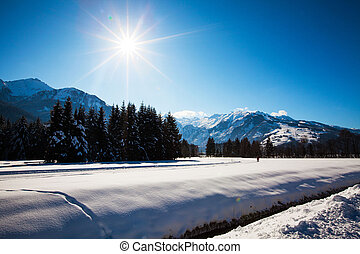 Winter Sunny landscape on the Alps mountains in Austria.