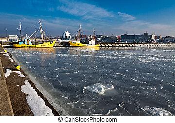 Winter sunrise in frosen harbor