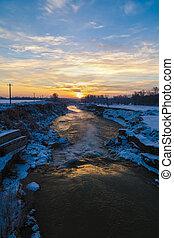 Winter sunrise on a river in Romania