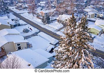 winter sunrise over a residential street