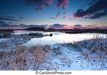 winter sunrise over river in snow