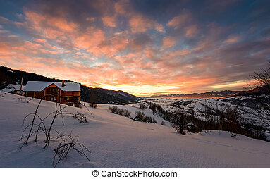 winter sunrise with red clouds in the village. beautiful...