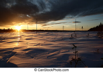 Winter sunset in Swedish Lapland, with breakable crust on the snow