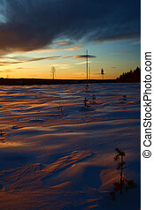 Winter sunset in Swedish Lapland, with breakable crust on the snow.