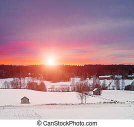 Winter sunset landscape with dramatic sky in Sweden, north...