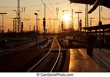 Winter sunset over Karlsruhe railway station with people...