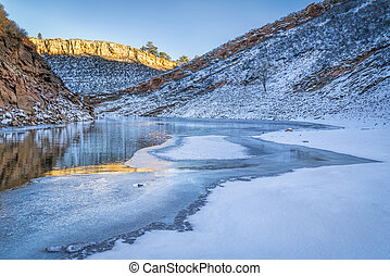 winter sunset over mountain lake