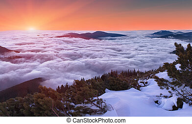 winter sunset over the clouds