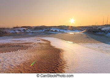 winter sunset sun on the horizon