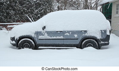 Winter SUV. - Profile of blue SUV under thick snow. Snow...