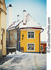 Winter Tallinn - Medieval street with colorful houses in Old...