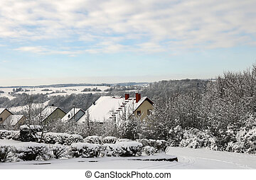 Winter. The roofs of the houses are covered with snow.