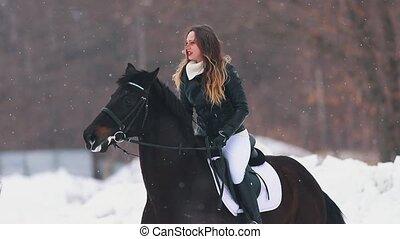 Winter time. Three women on horseback standing on snowy...