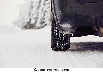 Winter tire - Detail of the tire on winter road