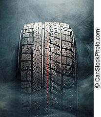 winter tire in smoke