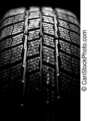 Winter tire isolated on black