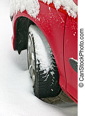Winter tires of a car in the snow. Driving in the winter.