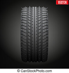 winter tires with metal spikes on dark background.